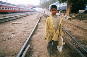 boy standing on railway lines